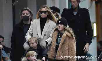 Abbey Clancy steps out with husband Peter Crouch and their children in London