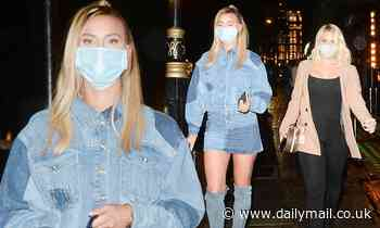 Ferne McCann puts on a leggy display in a denim mini skirt for a night out with Danielle Armstrong