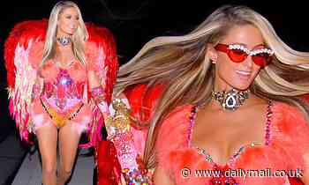 Paris Hilton is red hot as she dazzles in an extravagant red angel costume for Halloween in LA