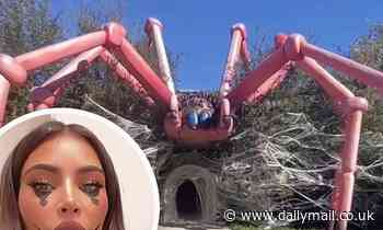 Kim Kardashian gives a tour of her home decked out for Halloween with a TARANTULA on of her house