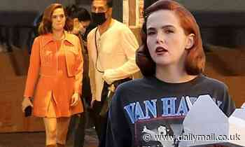 Zoey Deutch glams it up with bold red lip and retro curled hair