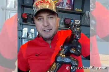 Tim Tebow's Heisman Trophy Now Belongs to Luke Bryan - Taste of Country