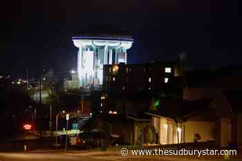 Water tower ringed with Christmas colours