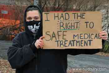 Sudbury woman holding a one-person demonstrate on the importance of masking up
