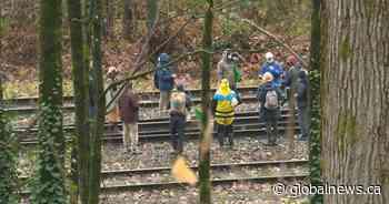 Anti-pipeline protesters block rail line near the Burnaby-Coquitlam border