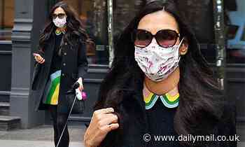 Famke Janssen look chic as she takes her new French Bulldog pup for a walk around the Big Apple - Daily Mail