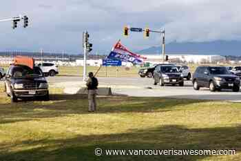 Trump supporter waving flag at Richmond, BC intersection attracts police - Vancouver Is Awesome