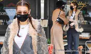 Bella Hadid goes hunting chic in fur-lined camouflage jacket at lunch with Kendall Jenner in NYC