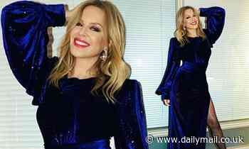 Kylie Minogue steps out in a blue velvet gown for Spanish chat show appearance