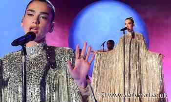 Dua Lipa looks radiant in a silver sequinned gown as she performs during the Graham Norton Show
