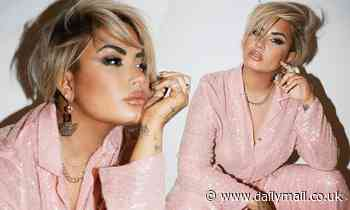 Demi Lovato shows off more of her edgy new half-shaved pixie cut as she glitters in a pink suit