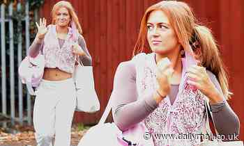 Strictly's Maisie Smith flashes her abs in a fluffy pink gilet and sweatpants