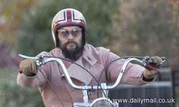 Jason Momoa rocks pink motorcycle jacket to ride his Harley in Toronto