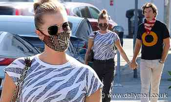Rebecca Romijnand husband Jerry O'Connell pack on the PDA and hold hands after lunch date in LA
