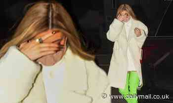 Kylie Jenner dons lime green thigh high boots with white dress and coat for dinner outing in LA