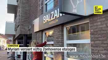 Myriam versiert vijftig Zonhovense etalages met positieve bo... (Zonhoven) - Het Nieuwsblad