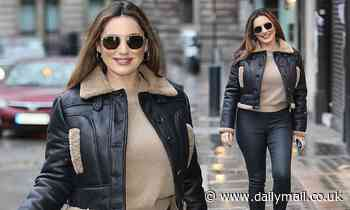 Kelly Brook cuts a chic figure in leather leggings and furry-trimmed jacket