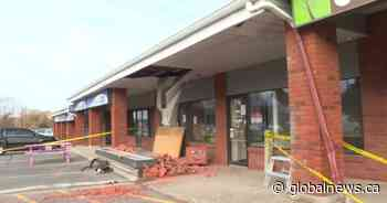 Kingston police investigate after car driven into building in city's west end