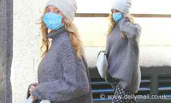 Pregnant Elsa Hosk keeps her baby bump bundled in a cozy grey sweater while out in NYC