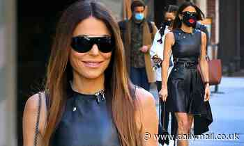 Bethenny Frankel shows off her VERY trim frame in a slinky leather LBD