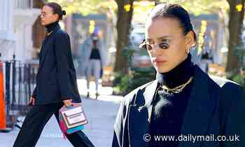 Irina Shayk looks sharp in a timeless black pant suit and turtleneck while out in NYC