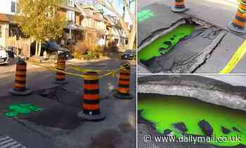 Huge sinkhole with glowing green liquid appears on Toronto street