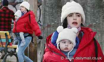Krysten Ritter bundles up her baby boy Bruce inside her windbreaker jacket