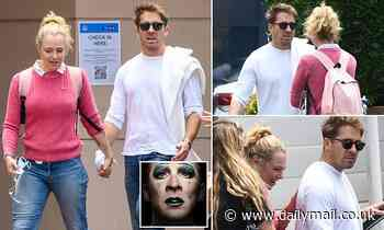 Hugh Sheridan is comforted byJessica Marais as he leaves hospital following treatment for anxiety