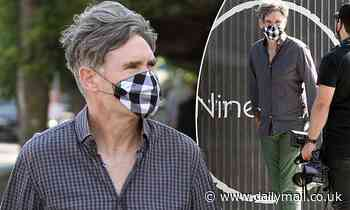 Dave Hughes wears a face mask as he inspects The Block properties