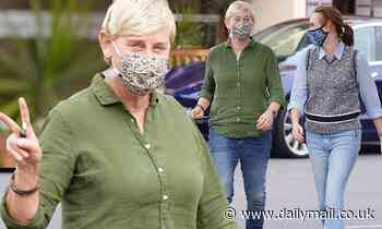 Ellen DeGeneres flashes a peace sign while out to lunch with a friend in Montecito