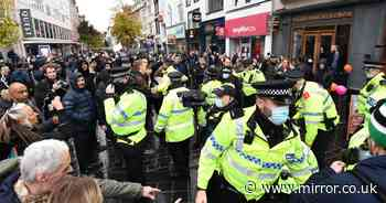 Lockdown protesters and police clash as crowd chant 'freedom' with 15 arrests