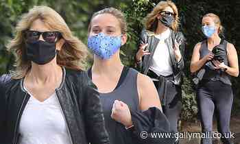 Reese Witherspoon and Laura Dern show their longtime off-screen friendship with masked LA stroll