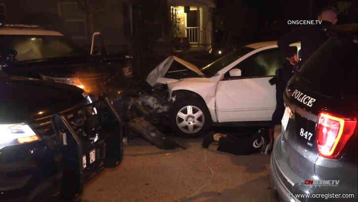 Man arrested, passenger dies after crashing into Santa Ana police car