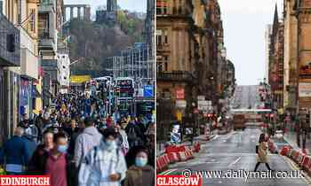 Crowds of shoppers flock to Edinburgh's bustling centre while Glasgow streets lie deserted