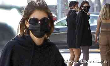 Kaia Gerber keeps it cozy and casual in oversized black hoodie for juice run in Beverly Hills