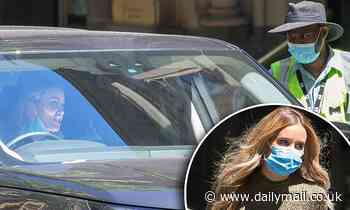 Rebecca Judd speaks to parking inspector as she returns to her car after visiting a jewellery store