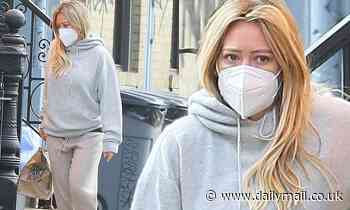 Hilary Duff picks up food delivered to her doorstep on the day she revealed that she's in quarantine
