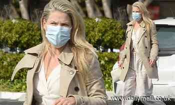 Ali Larter looks effortlessly chic in a white blouse and a trench coat as she grabs a coffee in LA