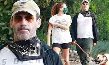 Jon Hamm and Anna Osceola take the dog out for an afternoon walk near his home in Los Feliz