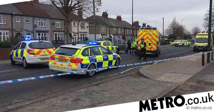 Woman dies after crash with ambulance responding to emergency