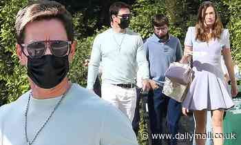 Mark Wahlberg sports a tight sweater and diamond crucifix to church with his family in Beverly Hills