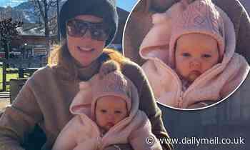 Tamara Ecclestone flashes a smile while cuddling her newborn Serena
