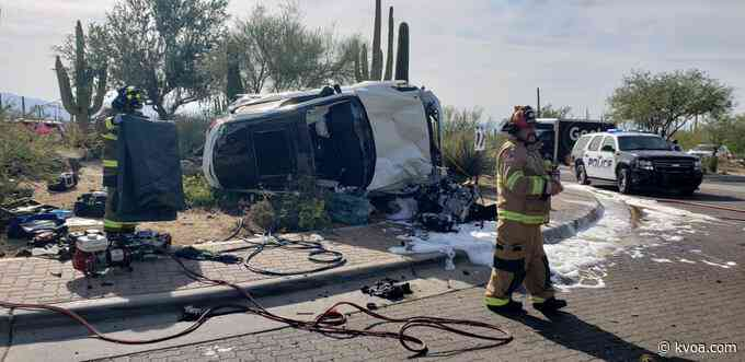 Single vehicle rollover leads to car catching fire