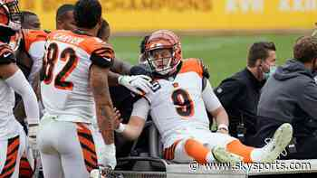 Bengals QB Burrow stretchered off with knee injury