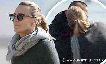 Robin Wright and husband Clement Giraudet put on an amorous display as they kiss on the beach