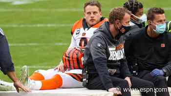Burrow carted off, hints at missing rest of season
