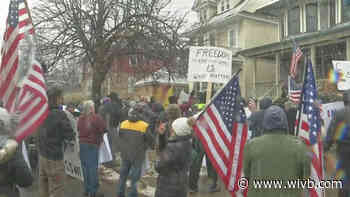 Protesters against new coronavirus restrictions gather outside Poloncarz's home