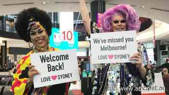 Passengers on first flight from Melbourne to Sydney met by drag queens and Bondi life guards