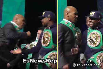 Watch when Mike Tyson threw a punch at Floyd Mayweather on stage and Mayweather didn't even flinch - talkSPORT.com