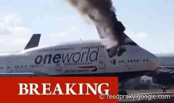 British Airways jet bursts into flames at Spanish airport - blaze erupts behind cockpit